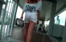 Curly doll flashes her ass and tits