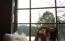 Sexy Latina GF strips and pleasures herself by the window
